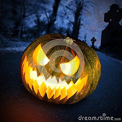 Scary halloween pumpkin in dark forest