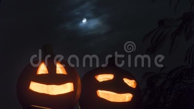 Scary halloween pumpkins with night sky stock video footage