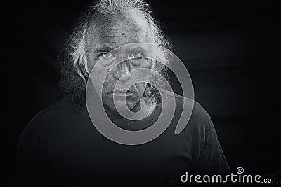Scary man staring at viewer