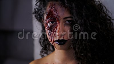 scary portrait of young zombie girl with halloween blood