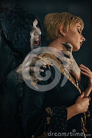 Free Scary Vampire Devil Biting Young Woman. Medieval Gothic Nightmar Royalty Free Stock Image - 85625136
