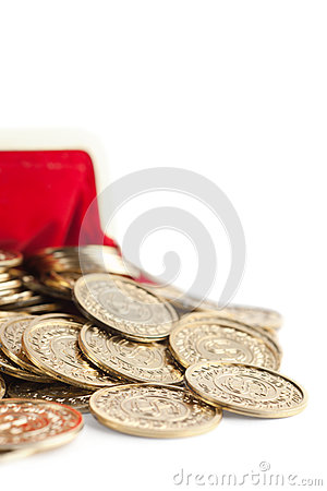 Scattered gold coins are in hot red purse