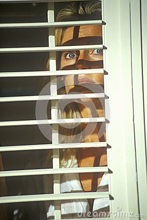 Scene with actress looking through blinds Editorial Image