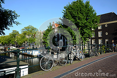 Scenic Bycicle in an Amsterdam Canal Editorial Stock Image
