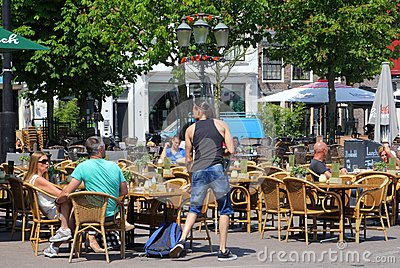 Couple relax at a cafe terrace in Amersfoort, Netherlands Editorial Photo