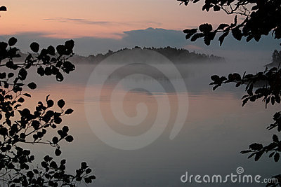Scenic view of misty lake