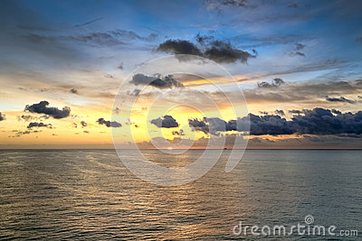 Scenic view of sunrise at ocean
