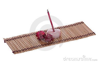 Scent joss stick, pebble and flower on mat for mental relaxation