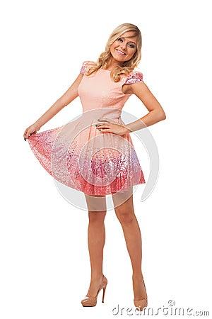 sch ne blondine die rosa kleid und schuhe tragen. Black Bedroom Furniture Sets. Home Design Ideas