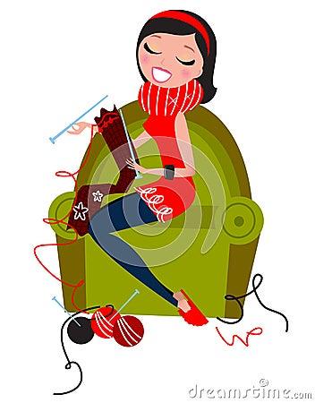 Schöne Frau, die handgemachte Strickwaren strickt