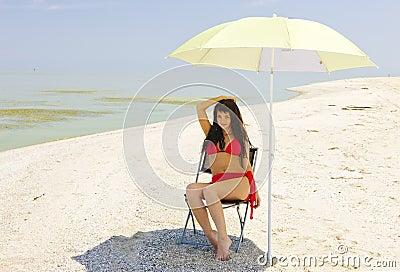 Schaduw op een heet strand.