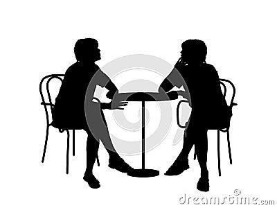am tisch sitzen