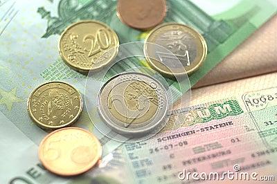 Schengen visa and euro coins for journey