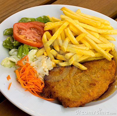 Schnitzel - cutlet with french fries and Salad