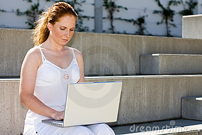 Scholar with laptop on stair