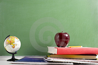 School Books a red Apple and a Globe