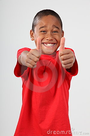 School boy 9 big toothy smile and thumbs up sign