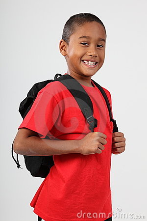 School boy 9 wearing red and happy smile in studio