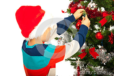 School boy decorate a tree