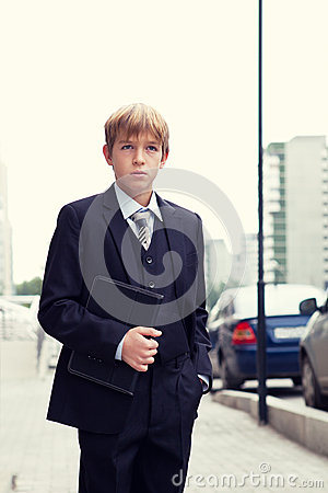School boy with electronic tablet
