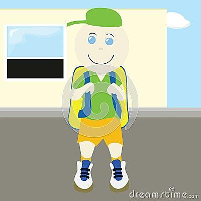 School boy in front of school
