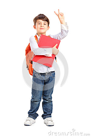 School boy holding a notebook and gesturing