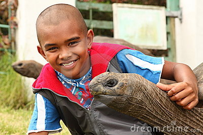 School boy visits the giant tortoises on St Helena