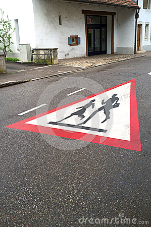School children crossing road sign