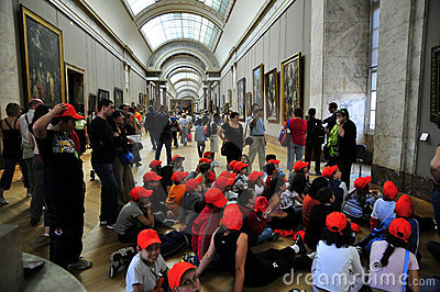School children with red beanies  at the Louvre Editorial Stock Image