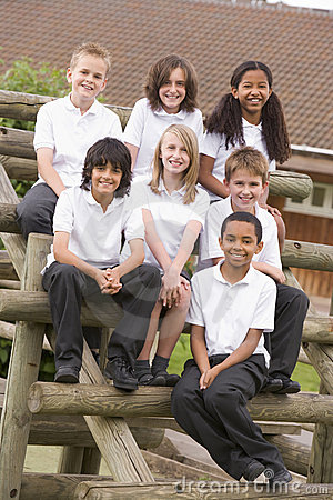 Free School Children Sitting On Benches Outside Royalty Free Stock Images - 6080839