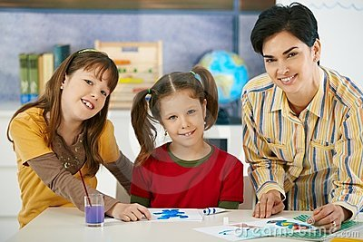 School children and teacher in art class