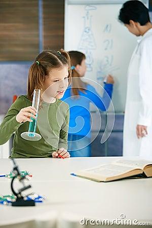 School children and teacher in science class