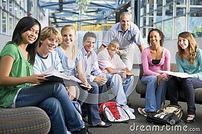 School children and their teacher in a class
