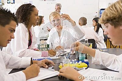 School children and their teacher in science class