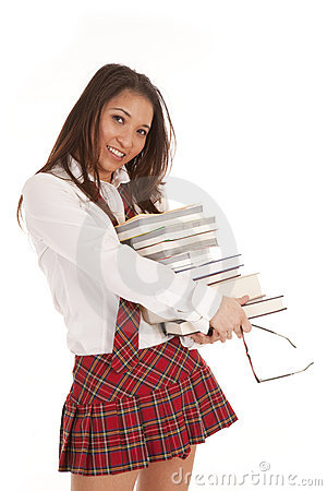 School girl with books holding