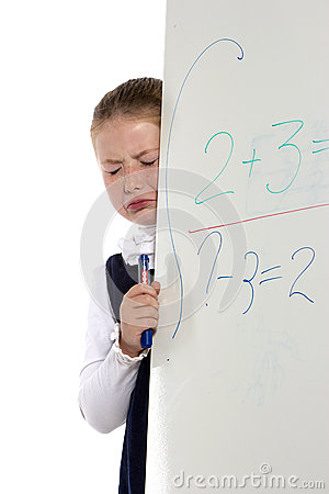 School girl cries standing near a board