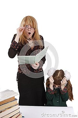 School girl gives teacher a shock. Education.