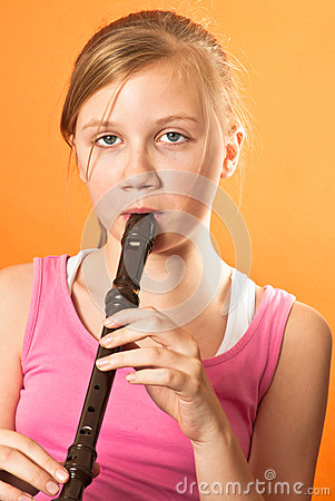 School girl playing the recorder