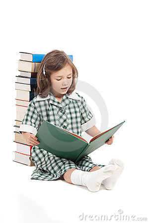 School girl reading library book