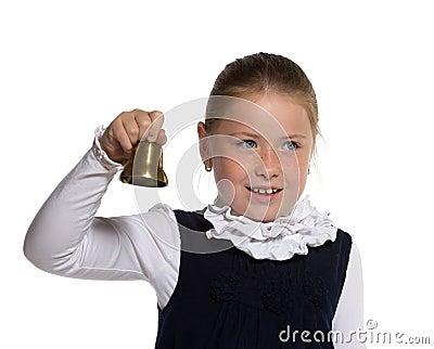 School girl ringing a golden bell