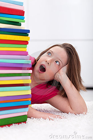 School girl shocked by the large stack of books