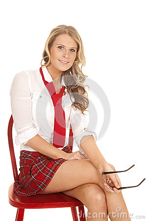 School girl sit red chair hold glasses smile