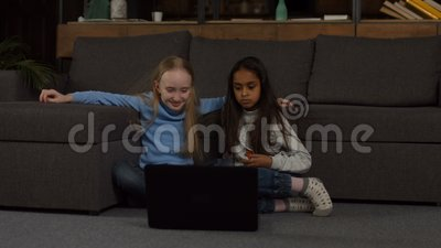 School girl studying on line with laptop at home stock video footage