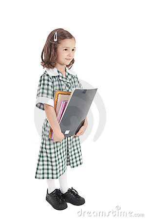 School girl in uniform with books