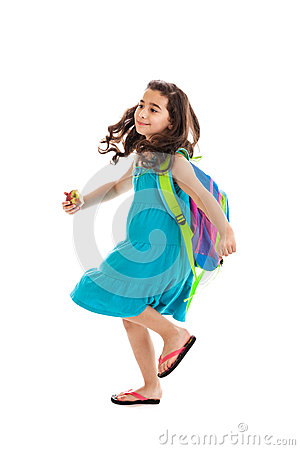 School girl walking isolated on white
