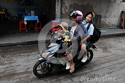 School Run by Motorbike Editorial Photo