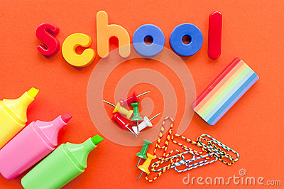 School supplies on orange background