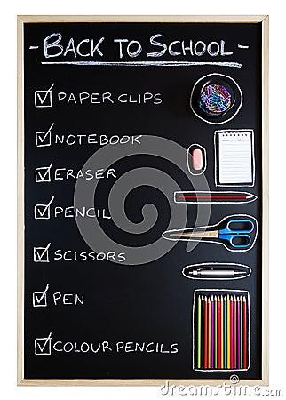 School supplies over blackboard background