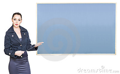 School Teacher Standing Next To Blank Blackboard