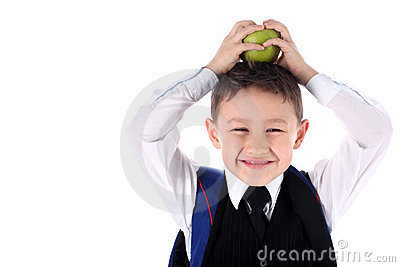 Schoolboy with backpack and apple